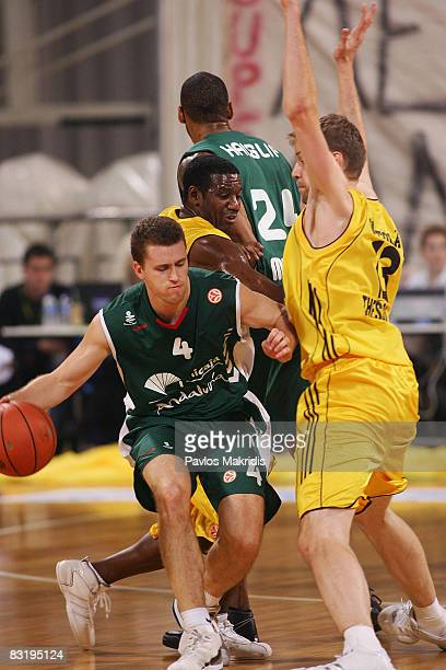 Hanno Mottola of Aris TT Bank and Bojan Popovic of Unicaja Malaga in action during the Euroleague Basketball Game 1 between Aris TT Bank and Unicaja...