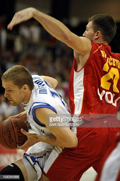 Hanno Mottola of Finland tries to get past Vladimir Draicevic of Montenegro during European Championships qualifying game Finland vs Montenegro in...