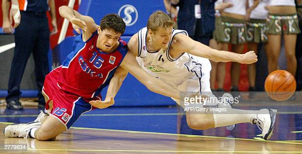 Hanno Mottola of Italian club Skipper Bologna battles for the ball with Alexander Bashminov of Russian club CSKA during their fifth round match of...
