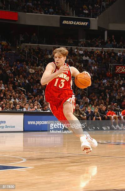 Hanno Mottola of the Atlanta Hawks drives upcourt during the game against the Washington Wizards at the MCI Center in Washington District of Columbia...