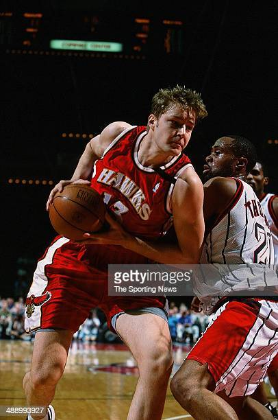 Hanno Mottola of the Atlanta Hawks moves around Kenny Thomas of the Houston Rockets during the game on April 7 2001 at Compaq Center in Houston Texas...