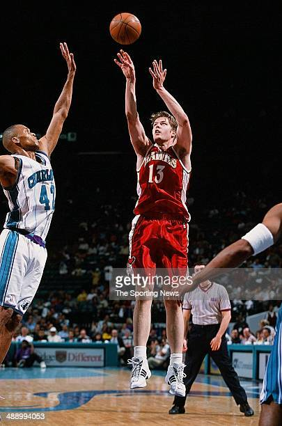 Hanno Mottola of the Atlanta Hawks puts a shot up over David Wesley of the Charlotte Hornets during the game on April 16 2001 at Charlotte Coliseum...
