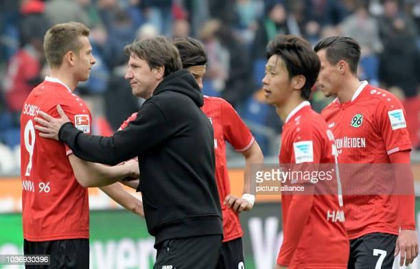 Hannover 96 coach Daniel Stendel thanks his players after the German Bundesliga game between Hannover 96 vs FC Schalke 04 in Hanover Germany 30 April...