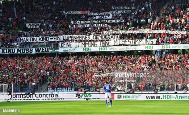 Hannover 96 fans hold up banners before the Bundesliga match between Hannover 96 and FC Schalke 04 at HDIArena on August 27 2017 in Hanover Germany