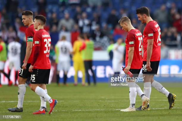 Hannover 96 look dejected following the Bundesliga match between Hannover 96 and Eintracht Frankfurt at HDIArena on February 24 2019 in Hanover...