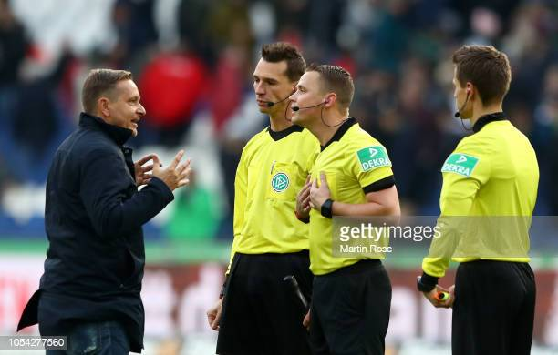 Hannover 96 Sporting Director Horst Heldt confronts the match officials after the Bundesliga match between Hannover 96 and FC Augsburg at HDIArena on...
