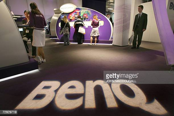 FILES A picture taken 14 March 2006 shows fairgoers visiting Taiwanbased wireless device giant Benq's stand during the 2006 CeBIT information and...