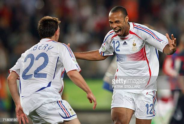French forward Thierry Henry and teammate forward Franck Ribery celebrate at the end of the World Cup 2006 round of 16 football game Spain vs....