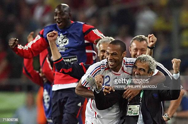 French head coach Raymond Domenech and French forward Thierry Henry celebrate with teammates at the end of the World Cup 2006 round of 16 football...