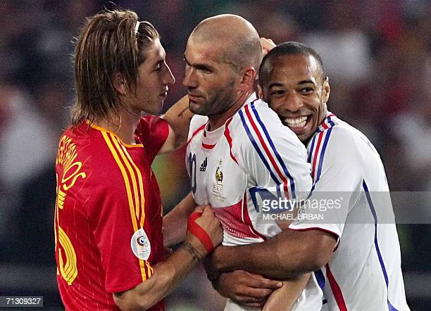French midfielder Zinedine Zidane and forward Thierry Henry celebrate in front of Spanish defender Sergio Ramos at the end of the World Cup 2006...