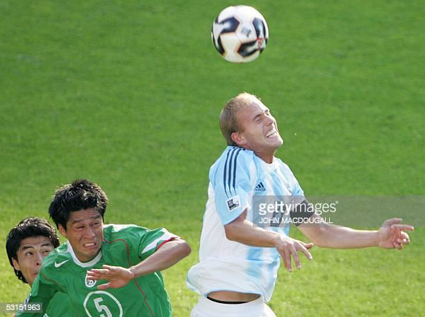 Mexican defender Rafael Marquez Mexican defender Ricardo Osorio vie with Argentine forward Luciano Figueroa during the 2005 FIFA Confederations Cup...