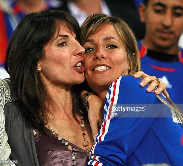 Veronique Zidane the wife of French midfielder Zinedine Zidane hugs Beatrice Trezeguet the wife of David Trezeguet at the end of the World Cup 2006...