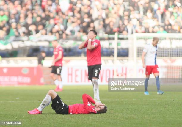 Hannover players react after the final whistle during the Second Bundesliga match between Hannover 96 and Hamburger SV at HDI-Arena on February 15,...