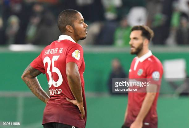 Hannover's Charlison Benschop and Kenan Karaman standing on the pitch after the DFBCup soccer match between VfL Wolfsburg and Hannover 96 in the...