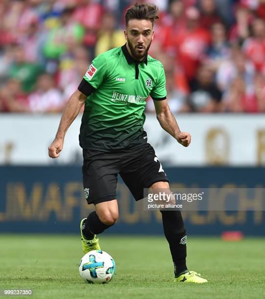 Hannover's Kenan Karaman in action during the German Bundesliga soccer match between FSV Mainz 05 and Hannover 96 in the Opel Arena in Mainz Germany...