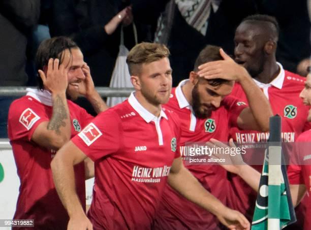 Hannover's Martin Harnik celebrates his 10 goal with Niclas Fuellkrug Kenan Karaman and Salif Sane during the German Bundesliga soccer match between...