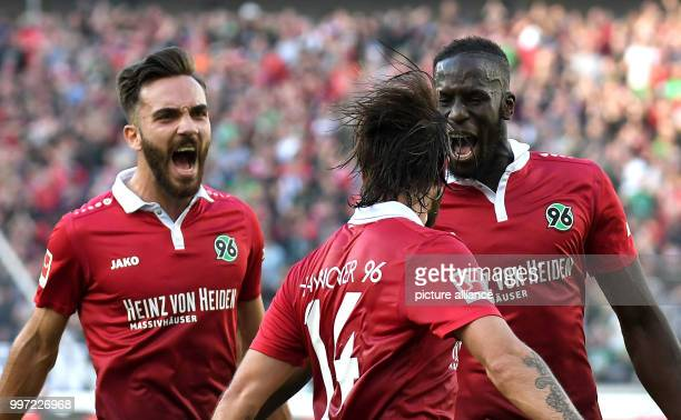Hannover's Salif Sane celebrating with Kenan Karaman and Martin Harnik the 11 equaliser against Eintracht Frankfurt during the German Bundesliga...