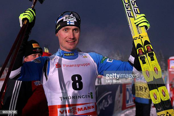 Hannu Manninen of Finnland celebrates after winning the Cross Country event of the FIS Nordic Combined World Cup at the Hans-Renner-Schanze on...