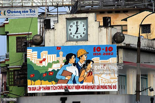 Hanoi city views and life A poster publicised the merit of the communist revolution in Hanoi