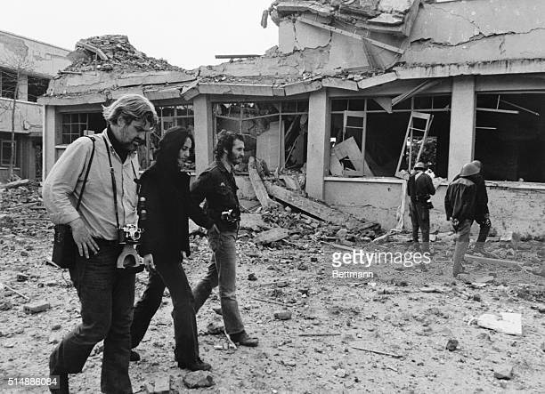 American folk singer Joan Baez and two other antiwar activists walk through Galem International Airport here Dec 21 The airport was bombed by US B52s...