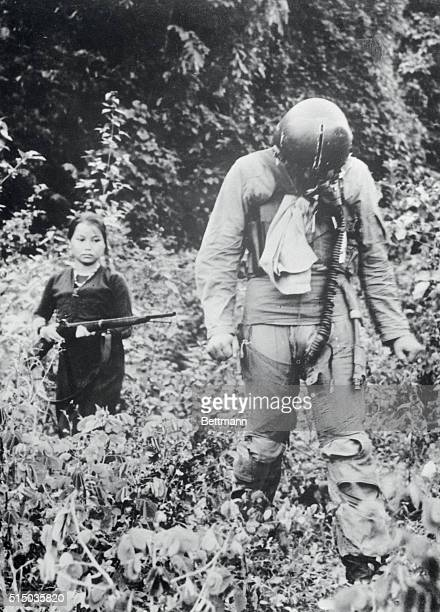 A young North Vietnamese woman keeps a gun trained on a US Air Force pilot after his plane was shot down near Hanoi September 7th The pilot was...