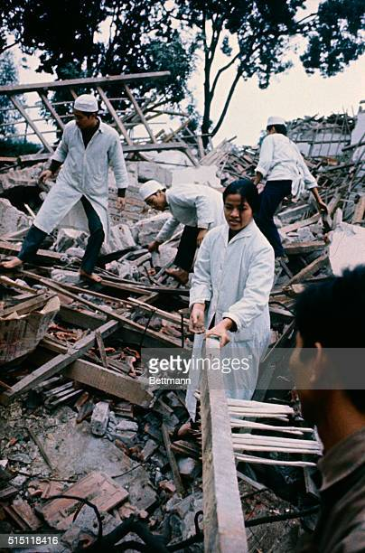 North Vietnamese doctors and nurses carry a box of medical supplies out of the destroyed BacMai hospital bombed by US B52 air raids on December 19...