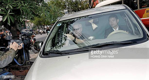 A bodyguard sitting in a van transporting Hollywood screen star Angelina Jolie gives the finger to press photographers as they drive in front of the...