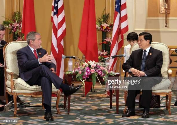 Chinese President Hu Jintao speaks with US President George W. Bush during their bilateral meeting at the Daewoo Hotel during the Asia-Pacific...