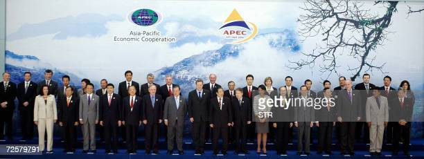 Delegates attending the AsiaPacific Economic Cooperation ministerial meeting pose for a group photo in Hanoi 16 November 2006 Front row LR Mexico's...