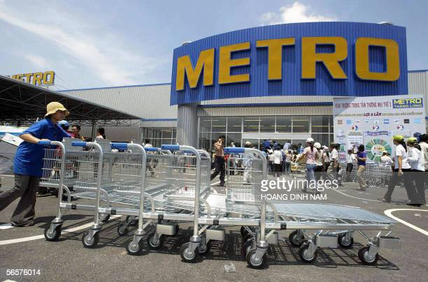 FILES A picture taken on 31 July 2003 shows an employee of the retail and distribution giant Metro pushing handcarts in front of the then newly...