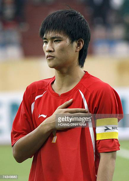 National team striker Le Cong Vinh listens to the country's national anthem at My Dinh Stadium in Hanoi prior to their match against Oman 18 April...