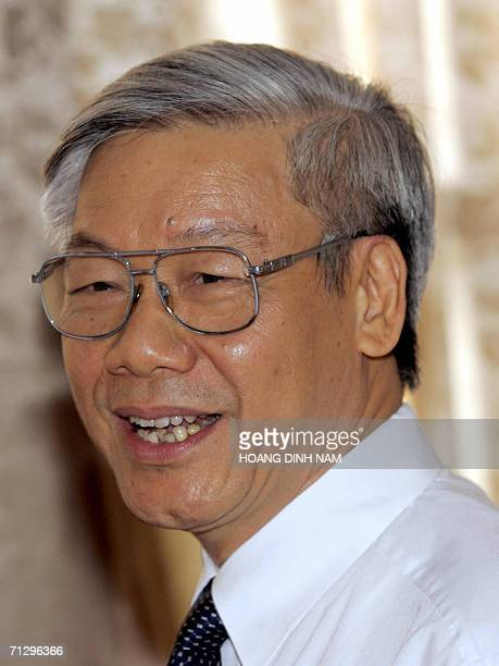 Newly elected National Assembly Chairman Nguyen Phu Trong smiles during a tea break at the national assembly in Hanoi 26 June 2006 Vietnam's national...