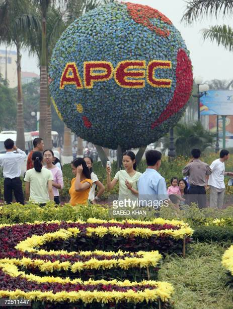 People gather to see flora decorations outside the venue of the upcoming AsiaPacific Economic Cooperation summit in downtown Hanoi 12 November 2006...