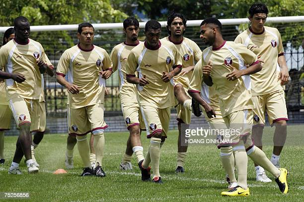Qatar team's players warm up during a training session in Hanoi 07 July 2007 in Hanoi Four countries Indonesia Malaysia Thailand and Vietnam are...