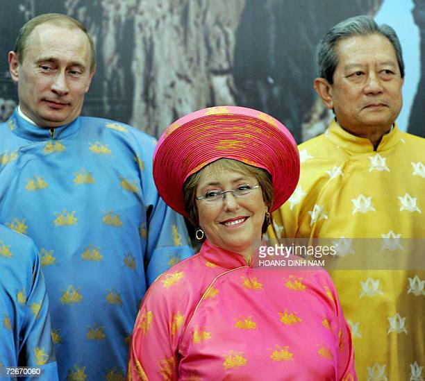 Russian President Vladimir Putin Chile President Michelle Bachelet and Thailand's militaryinstalled Prime Minister Surayud Chulanont listen to...