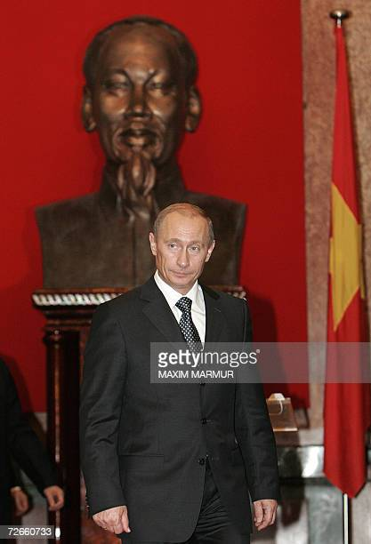 Russian President Vladimir Putin leaves the president place past a bust of the late Vietnamese leader Ho Chi Minh following a ceremony in Hanoi, 20...