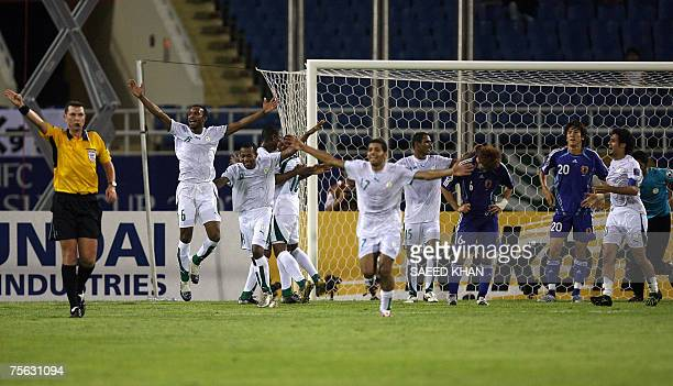 Saudi Arabian team players celebrate their victory over Japan in the semifinals of the Asia Football Cup 2007 in Hanoi 25 July 2007 Saudi Arabia...