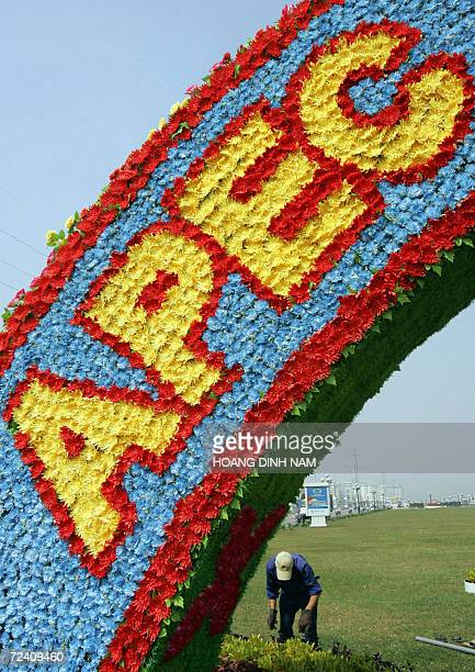 TO GO WITH APECsummitVietnampreparationssched A gardener works next to a pavillon made of plastic flowers along a road leading to the venue of the...