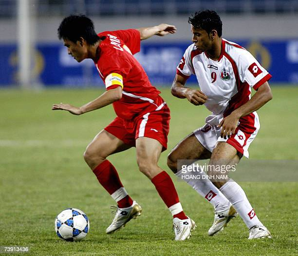 Vietnamese striker Le Cong Vinh controls the ball in front of Oman's Mohammed Ghassani during an Olympic Beijing 2008 qualifying soccer return match...