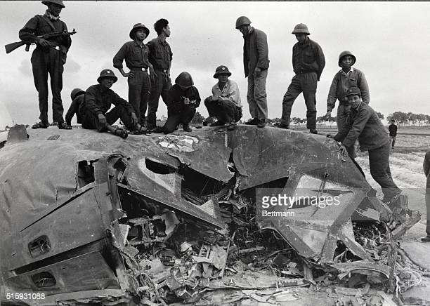 N Vietnamese soldiers mount the wreckage of a US B52 bomber here Dec 20 which the Communists claimed to have downed in Vinh Phu Privince late Dec 18...