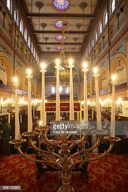 hanoukka in the nazareth synagogue, paris - menorah stock pictures, royalty-free photos & images