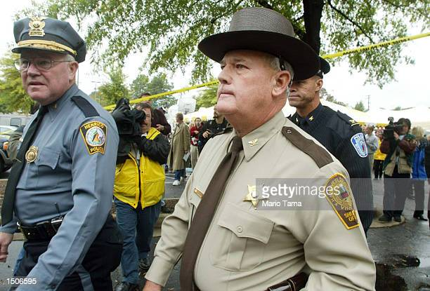 Hanover County Sheriff V Stuart Cook Leaves A News Conference Near An Eon Gas Station Where