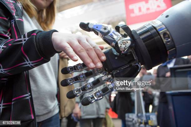 Hanover Fair 2017 Much admired shake hands with the human robot model of a 5Finger Gripping Hand