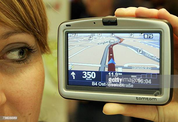 A model presents a navigation system from 'TomTom' at the CeBIT computer digital IT and telecommunications fair 16 March 2007 at the fair grounds in...