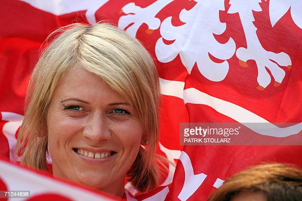 Polish supporter cheers her team prior to the World Cup 2006 group A football game Costa Rica vs. Poland, 20 June 2006 at Hanover stadium. AFP PHOTO...