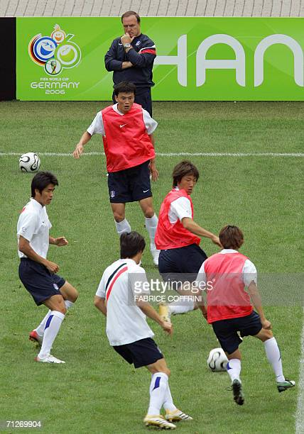 Dutch head coach of the South Korean team Dick Advocaat watches his players during a practice session at the WM-Stadion, 22 June 2006 in Hanover on...