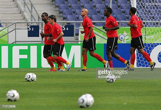 Players of the Angolan team forward Akwa, midfielder Figueiredo, defender Kali, forward Andre Titi Buengo and defender Rui Marques jog during a...