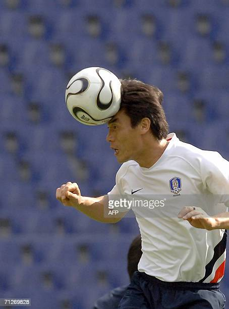South Korean defender Choi Jin Cheul heads the ball during a training session at the World Cup Stadium in Hanover, 22 June 2006. South Korea will...