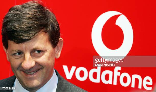 Vittorio Colao, chief of Vodafone Europe smiles as he poses for photographers at the CeBIT computer, digital IT and telecommunications fair 15 March...