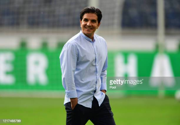 Hanover Head Coach Kenan Kocak walks across the pitch before the Second Bundesliga match between Hannover 96 and SG Dynamo Dresden at HDI-Arena on...